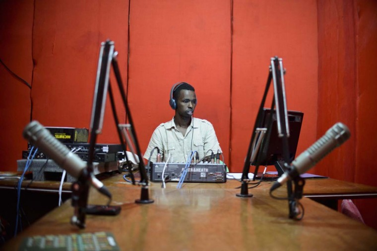 A worker is seen at Radio Shabelle, one of the most popular radio stations in Mogadishu December 8, 2012. The station has exposed itself to considerable danger in the past for actively taking a stance against the terrorist organiztion Al-Shabab, local media reported. Picture taken December 8, 2012. (Tobin Jones/Handout via Reuters)