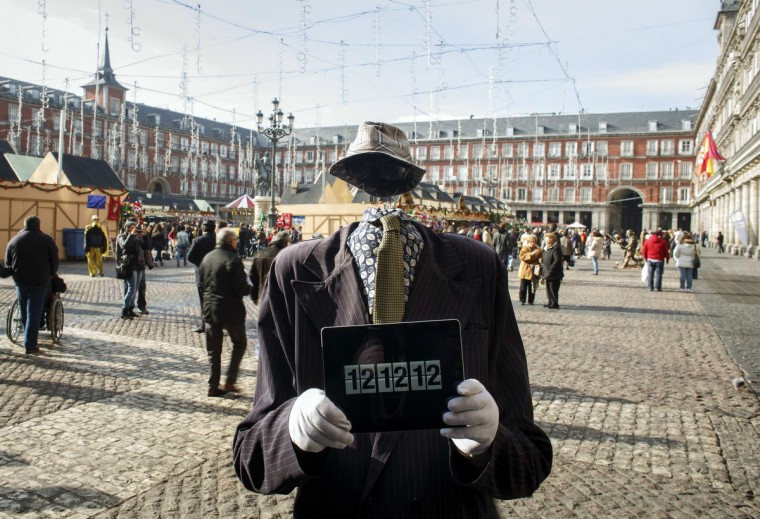 A street performer poses with an iPad with the time reading 12:12:12 in the Plaza Mayor in Madrid, December 12, 2012. December 12, 2012 is the last day in this century where the numeral date can be all the same number. (Paul Hanna/Reuters)