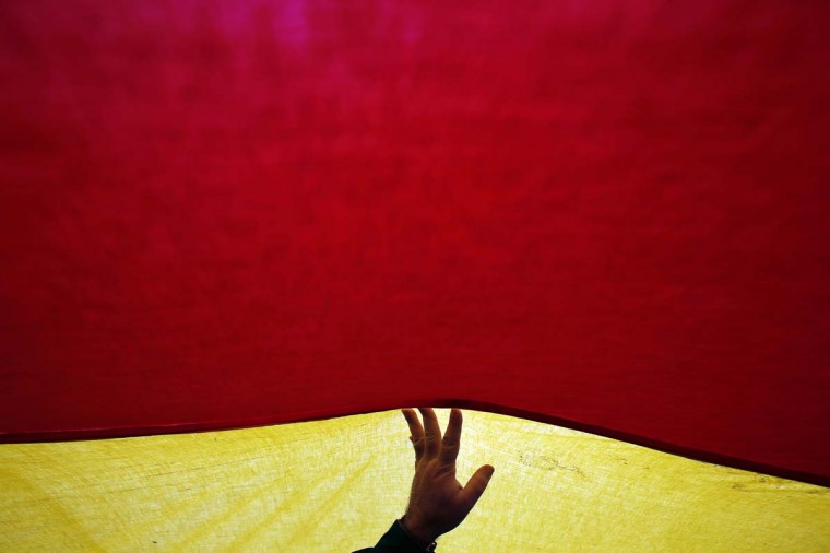People hold a giant Spanish flag during a rally for the defense of the unity of Spain on the day of the 34th anniversary of the Spanish Constitution at Madrid's Colon Square. (Susana Vera/Reuters photo)