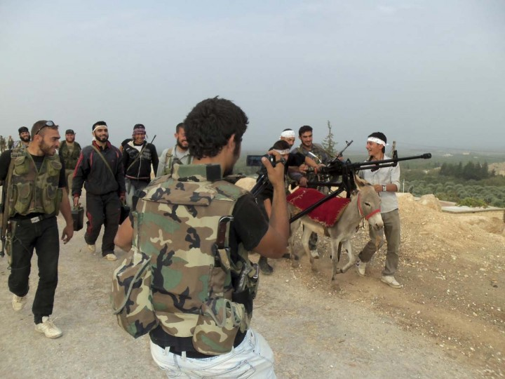 Free Syrian Army fighters transport a weapon on a donkey after clashes with forces loyal to President Bashar al-Assad, in Harem near Idlib. Picture taken October 22, 2012. (Redwan al-Homsi/Shaam News Network/Reuters)