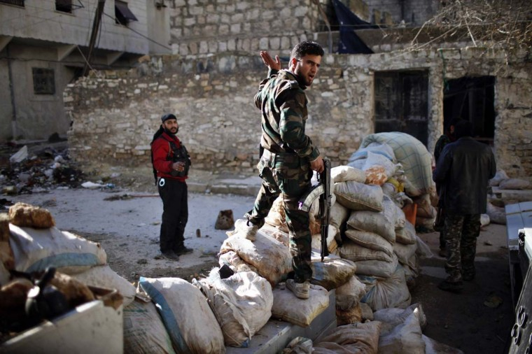 Free Syrian Army fighters take their position at the front line during a fight with forces loyal to Syrian President Bashar al-Assad in Aleppo December 26, 2012. (Ahmed Jadallah/Reuters)