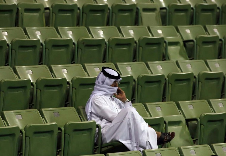 A man watches the tennis game between Russia's Nikolay Davydenko and Victor Hanescu of Romania during their Qatar Open tennis match in Doha December 31, 2012. (Jamal Saidi /Reuters)