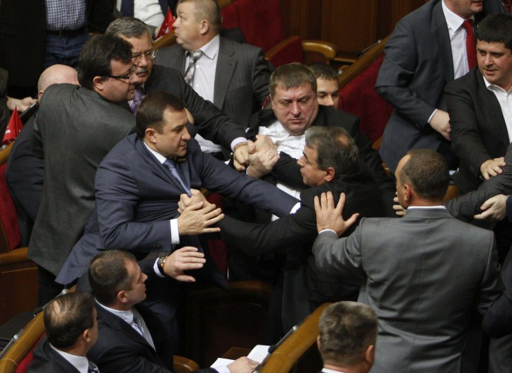 Parliament members scuffle over voting rules during the first session of the newly-elected Ukrainian parliament in Kiev. A session of Ukraine's new parliament collapsed amid chaos when brawls erupted among opposition deputies and those of the ruling party over the election of parliamentary officials. (Anatolii Stepanov/Reuters photo)