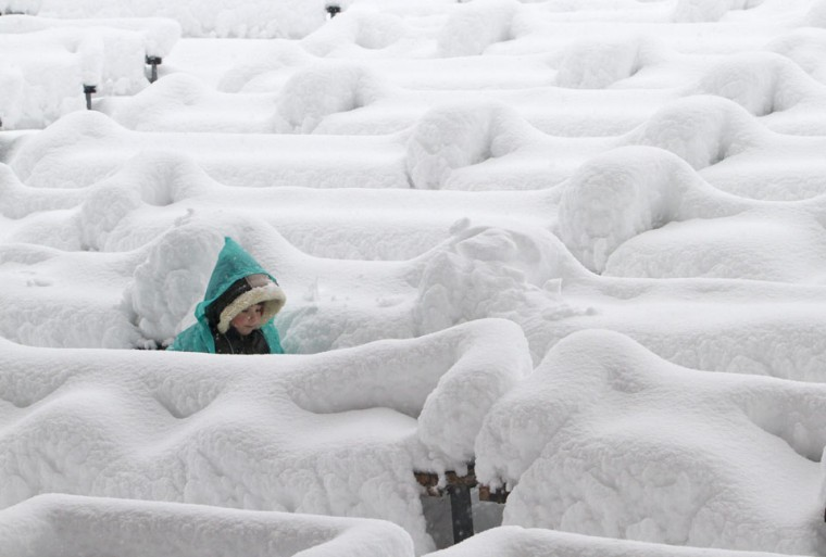 A child walks in a park after heavy snowfall in Kiev, Ukraine. (Anatolii Stepanov/Reuters)