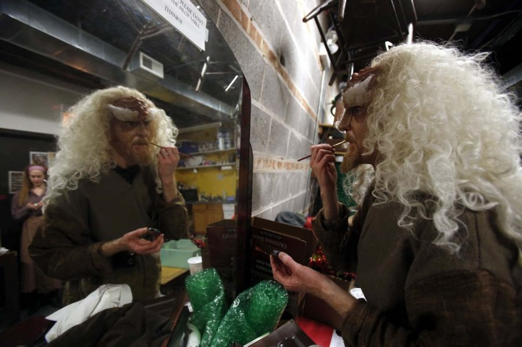 "Performer Kevin Alves is reflected in a mirror as he puts on make-up for a performance in ""A Klingon Christmas Carol"" in Chicago, December 20, 2012. (Jim Young/Reuters)"