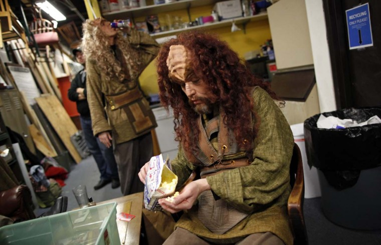 "Performers Clark Bender (R) and Erik Johnson have some snacks before a performance in ""A Klingon Christmas Carol"" in Chicago, December 20, 2012. (Jim Young/Reuters)"
