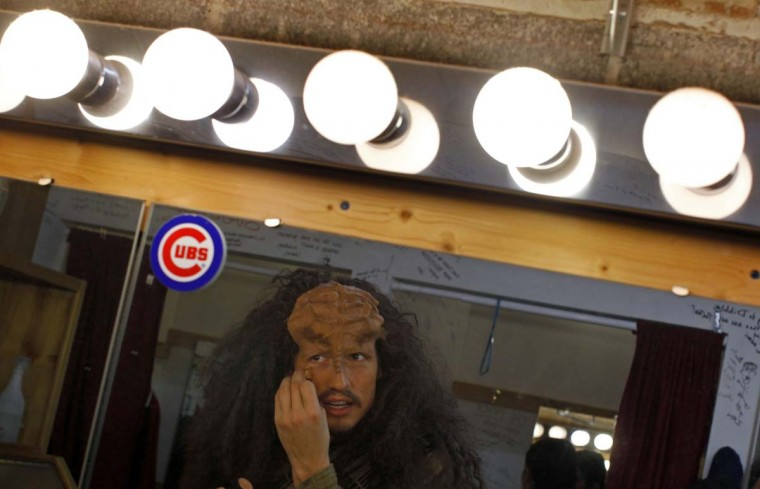 "Performer Jon Beal puts on make-up for a performance in ""A Klingon Christmas Carol"" in Chicago, December 20, 2012. (Jim Young/Reuters)"
