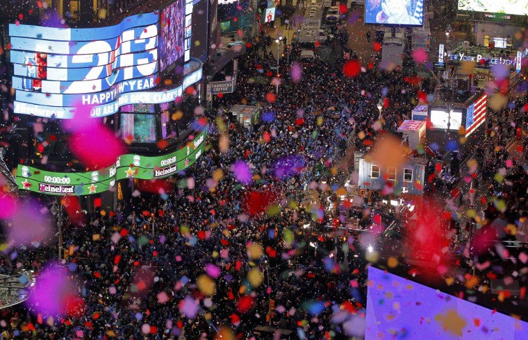 Confetti is dropped on revelers at midnight during New Year celebrations in Times Square in New York. (Gary Hershorn/Reuters)