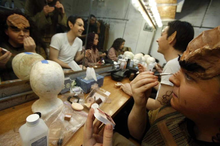 "Performers put on their make-up backstage as they prepare for a performance in ""A Klingon Christmas Carol"" in Chicago, December 20, 2012. (Jim Young/Reuters)"