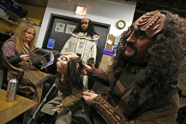 "Josh Zagoren (R) plays with a puppet used to represent ""Tiny Tim"" backstage before a performance of ""A Klingon Christmas Carol"" in Chicago, December 20, 2012. (Jim Young/Reuters)"