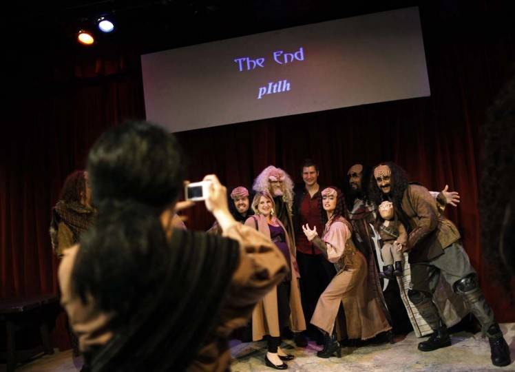 "An audience member is surrounded by the cast of ""A Klingon Christmas Carol"" as they pose for pictures after a performance in Chicago, December 20, 2012. (Jim Young/Reuters)"