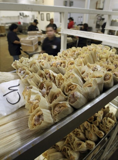 Workers prepare tamales during the holiday rush at Delicious Tamales in San Antonio, Texas. A Mexican-American tradition, tamale sales spike during the Christmas holiday season. (Erich Schlegel/Reuters)