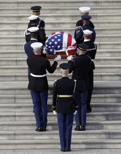 A military honour guard carries the casket of Senator Daniel Inouye (D-HI) on the steps of U.S. Capitol in Washington. Democratic Senator Inouye, a decorated World War Two veteran who lost an arm in battle and represented Hawaii in Congress since its statehood more than a half century ago, died on Monday at age 88. (Yuri Gripas/Reuters photo)
