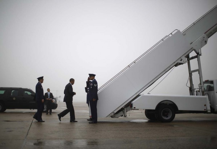 U.S. President Barack Obama steps aboard Air Force One at Andrews Air Force Base near Washington, December 10, 2012. Obama is travelling to Michigan for an event on the economy. (Jason Reed/Reuters)