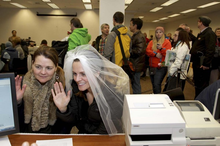 Jeri Andrews (L), 43, and Amy Andrews, 33, swear an oath that the paperwork for their marriage license is accurate in Seattle, Washington. A law legalizing same-sex matrimony took effect in Washington state on Thursday, and officials geared up for a flood of marriage-license applications from gay and lesbian couples eager to exchange vows. Washington made history last month as one of three U.S. states where marriage rights were extended to same-sex couples by popular vote, joining Maryland and Maine in passing ballot initiatives recognizing gay nuptials. (Marcus Donner/Reuters photo)