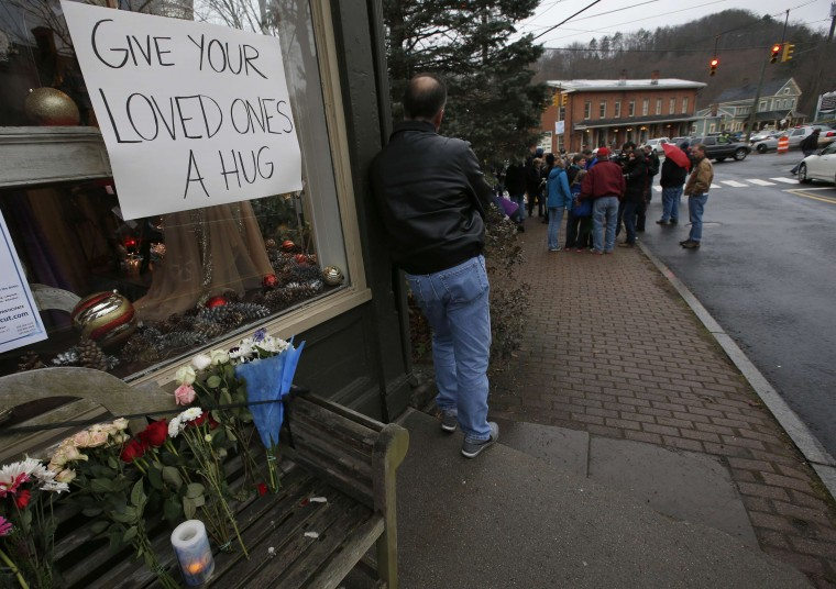 A man stands near a makeshift memorial near the Sandy Hook Elementary School for the victims of a school shooting in Newtown, Connecticut early December 16, 2012. Twelve girls, eight boys and six adult women were killed in the shooting on Friday at the Sandy Hook Elementary School in Newtown. (Mike Segar/Reuters)