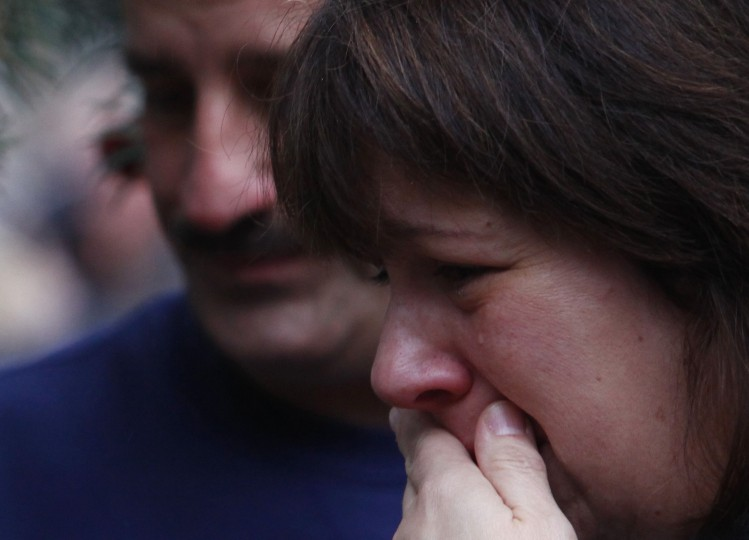 A woman cries at a memorial near Sandy Hook Elementary School in Newtown, Connecticut December 16, 2012. Twelve girls, eight boys and six adult women were killed in a shooting on Friday at Sandy Hook Elementary School in Newtown. (Eric Thayer/Reuters)