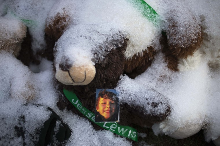 An image of six-year-old Jesse McCord Lewis, one of 20 schoolchildren killed in the December 14 shootings at Sandy Hook Elementary School, sits on a snow-covered teddy bear on Christmas morning in Newtown, Connecticut December 25, 2012. (Adrees Latif/Reuters)