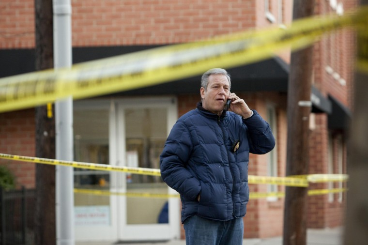 A plainclothes police officer talks on his mobile phone at a crime scene related to the shootings at Sandy Hook Elementary School, in Hoboken, New Jersey. In Hoboken, New Jersey, police cordoned off a block in connection with the Connecticut shootings but an officer told reporters there was no body inside, contrary to an earlier media report. (Andrew Kelly/Reuters)
