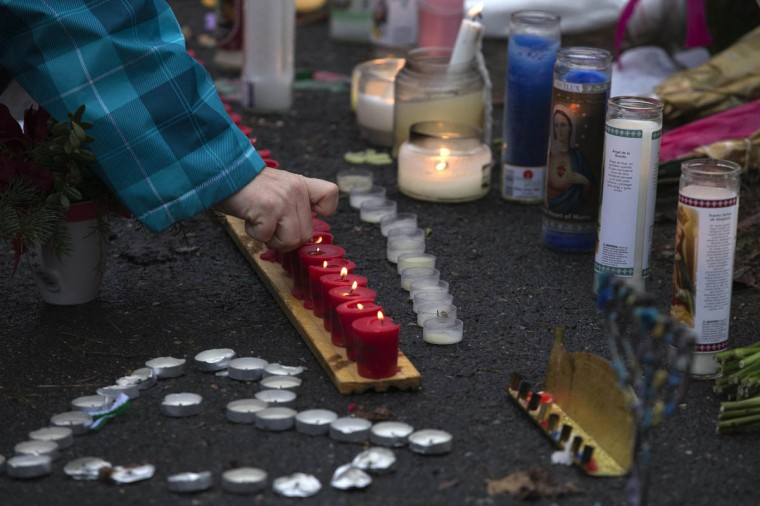 A well-wisher lights candles at a memorial for victims of the Sandy Hook Elementary shooting in Newtown, Connecticut December 16, 2012. Worshippers filled Sunday services to mourn the victims of a gunman's elementary school rampage that killed 20 children and six adults with President Barack Obama due to appear later at an interfaith vigil to help this shattered Connecticut town recover. (Adrees Latif/Reuters)
