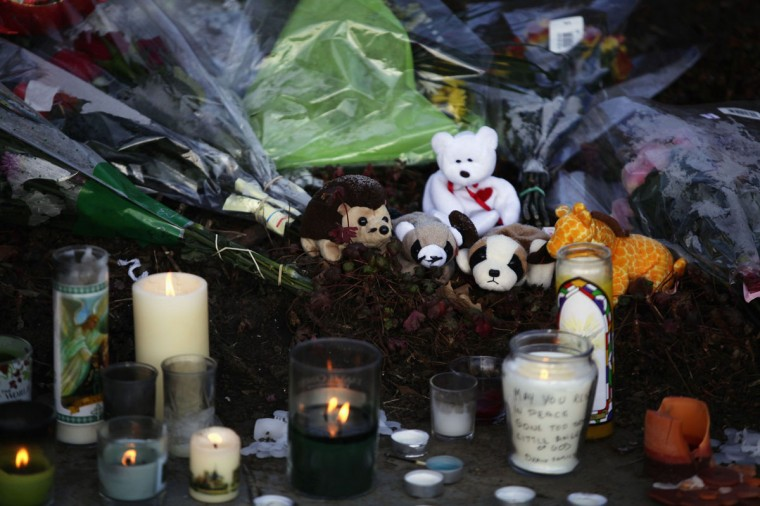 A makeshift memorial with flowers, stuffed animals and candles sits outside Saint Rose of Lima Roman Catholic Church in Newtown, Connecticut. People in the small Connecticut community grieved on Saturday over one of the deadliest school shootings in U.S. history, in which a gunman killed 20 children at Sandy Hook Elementary School. (Joshua Lott/Reuters)