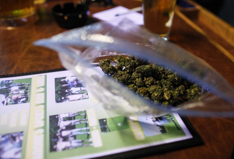 A customer's bag of one ounce of marijuana sits at the table at Frankie Sports Bar and Grill in Olympia, Washington on December 9, 2012. (Nick Adams/Reuters)