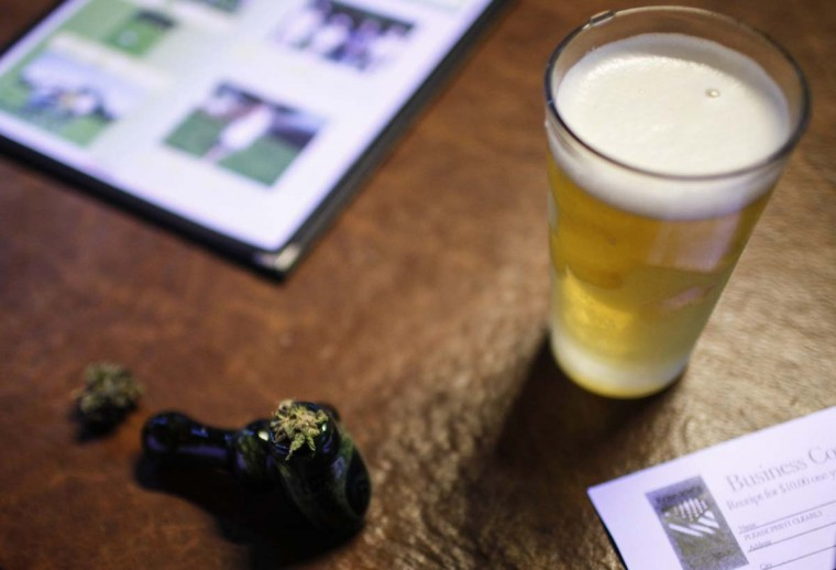 A customer's marijuana packed bowl along with his beer sits on the table at Frankie Sports Bar and Grill in Olympia, Washington on December 9, 2012.The owner Frank Schnarr, who waged an ultimately successful battle with local and state officials over Washington's 2006 smoking ban, appears to be the first restaurant or bar owner in the state to test the recently expanded limits on recreational marijuana use. (Nick Adams /Reuters)