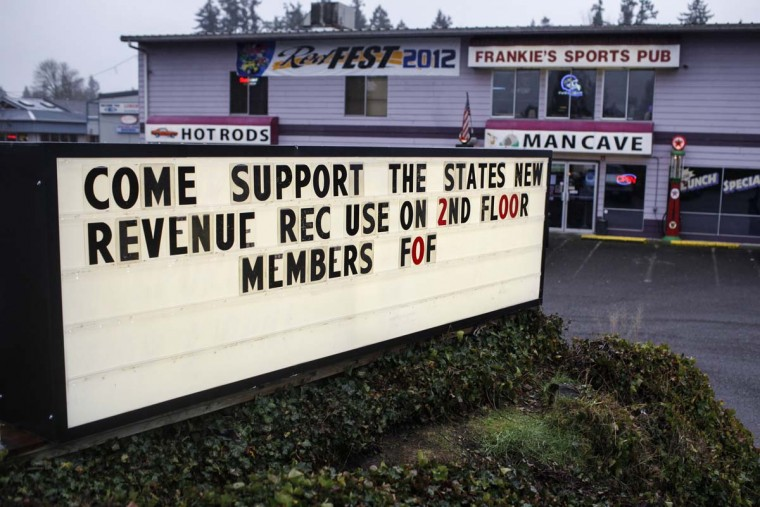 Outside a sign welcomes potential patrons to Frankie Sports Bar and Grill which recently started allowing smoking of marijuana inside the second floor of the bar in Olympia, Washington December 9, 2012. (Nick Adams/Reuters)
