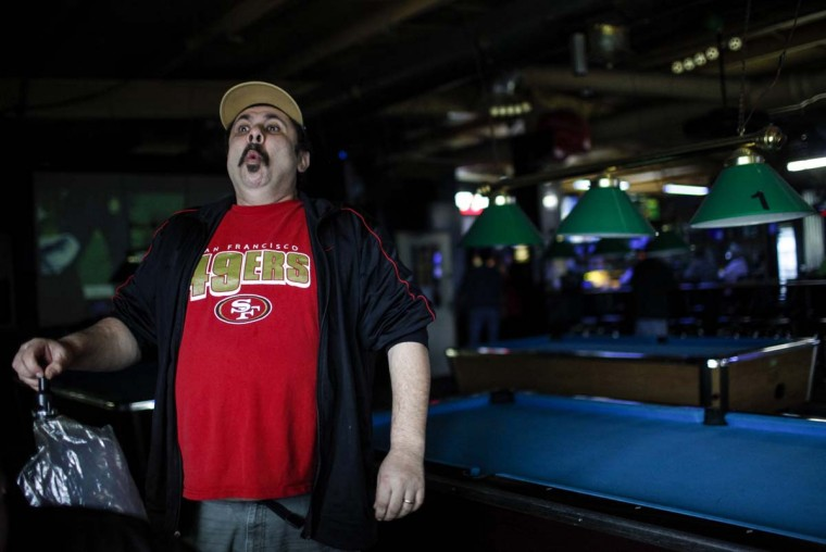Medical marijuana patient Robert Badillo smokes vaporized marijuana inside Frankie Sports Bar and Grill in Olympia, Washington on December 9, 2012. (Nick Adams/Reuters)