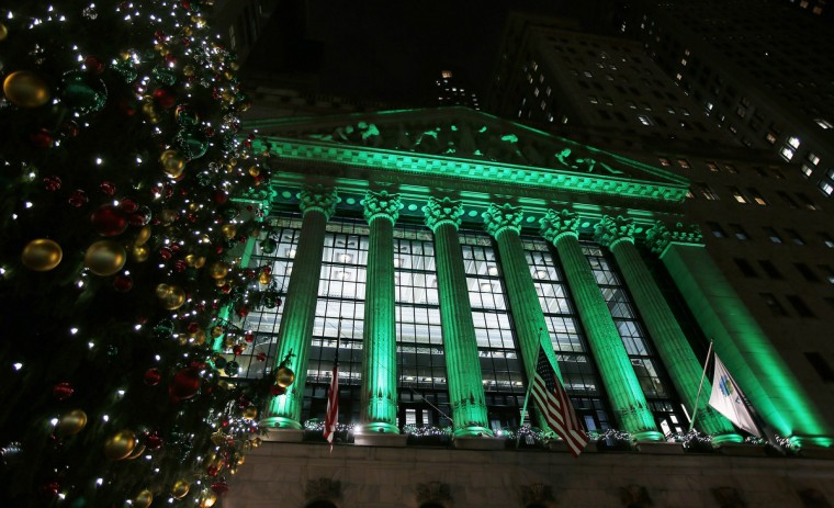 The New York Stock Exchange is seen lit up in Christmas green in New York. (Carlo Allegri/Reuters)