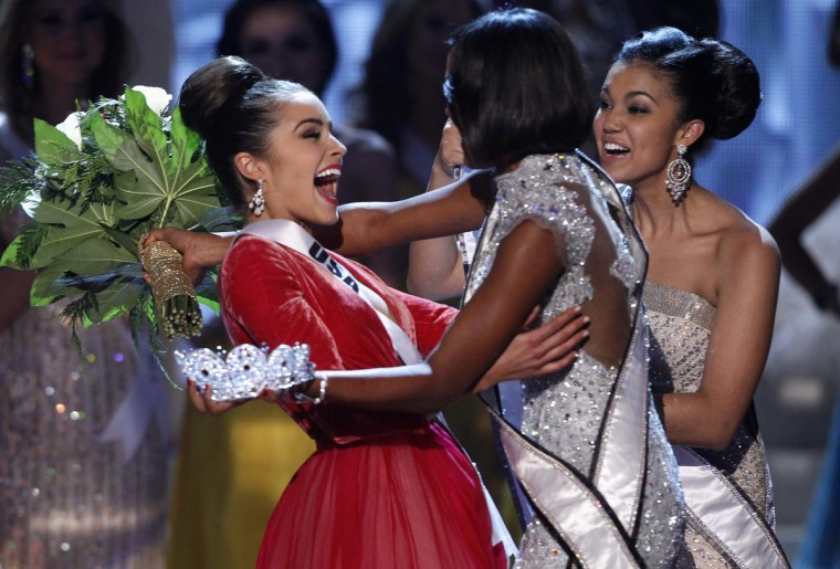Miss USA Olivia Culpo (L) is congratulated by Miss Universe 2011 Leila Lopes of Angola (C) during the Miss Universe pageant at Planet Hollywood Resort and Casino in Las Vegas, Nevada. Miss Teen USA 2012 Logan West is seen at right. (Steve Marcus/Reuters photo)