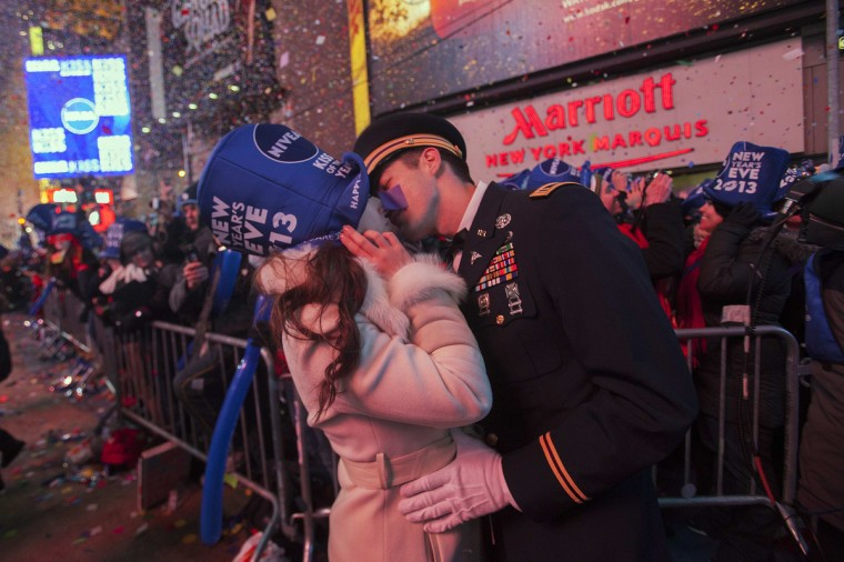 National Guardsman John Cebak (R) kisses his fiancee Sonja Babic at the start of the new year in Times Square in New York January 1, 2013. (Keith Bedford/Reuters)