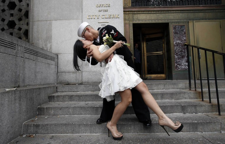 U.S. Navy Petty Officer 3rd Class EO3 John Chen, 23, from Lakehurst, New Jersey, kisses his new bride Victoria Chan, 25, from Manhattan, as they pose for photographers after they were married in a civil ceremony at New York City's Office of the City Clerk December 12, 2012. Hundreds of couples packed the office in lower Manhattan to be married on the date 12/12/12 as this will be the last such triple date for almost a century until January 1, 2101. (Mike Segar/Reuters)