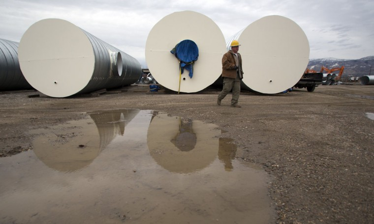 "Paul Seyfried walks past bunkers he is constructing for clients at Utah Shelter Systems in North Salt Lake, Utah, on December 12, 2012. The price of the shelters range from $51,800 to $64,900. Bunkers are being purchased or built by ""preppers"", a group of people actively preparing for serious catastrophes, like the apocalypse forecast some have forecasted based on the Mayan calendar. (Jim Urquhart/Reuters)"