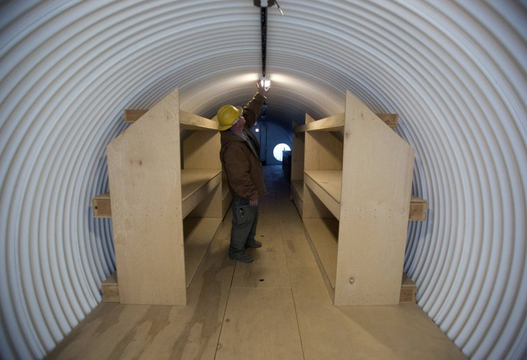 "Paul Seyfried works in a bunker he is constructing for a client at Utah Shelter Systems in North Salt Lake, Utah, on December 12, 2012. The price of the shelters range from $51,800 to $64,900. Bunkers are being purchased or built by ""preppers"", a group of people actively preparing for serious catastrophes, like the apocalypse forecast some have forecasted based on the Mayan calendar. (Jim Urquhart/Reuters)"