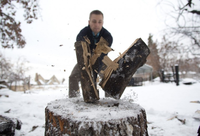 "Hugh Vail cuts firewood at his home in Bountiful, Utah, on December 10, 2012. Vail is part of the ""prepper"" movement, a group of people actively preparing for emergencies. While most preppers discount the Mayan calendar doomsday prophecy, many are still getting ready for potential catastrophes as the end of the year approaches. (Jim Urquhart/Reuters)"