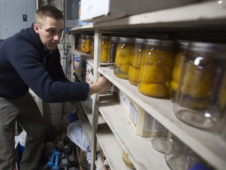 "Hugh Vail inventories his food storage at his home in Bountiful, Utah, on December 10, 2012. Vail is part of the ""prepper"" movement, a group of people actively preparing for emergencies. While most preppers discount the Mayan calendar doomsday prophecy, many are still getting ready for potential catastrophes as the end of the year approaches. (Jim Urquhart/Reuters)"