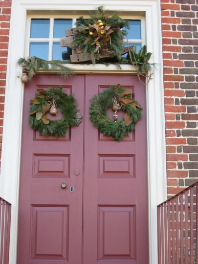 A wooden sled above the door and leather toy balls in the wreaths complete the children's theme on this door. (Susan Reimer/Baltimore Sun)