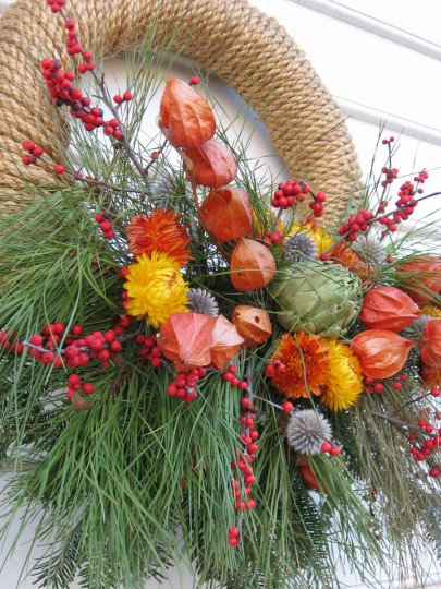 Cord and delicate Chinese lantern flowers adorn this wreath, along with straw flowers and avocados. (Susan Reimer/Baltimore Sun)