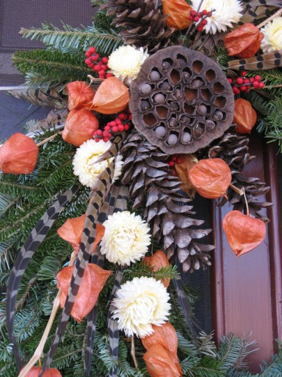 A detail of this wreath shows lotus pods, Chinese lanterns, pine cones and straw flowers. Floral stays and wire can be used. So can glue guns. But they must be invisible. (Susan Reimer/Baltimore Sun(