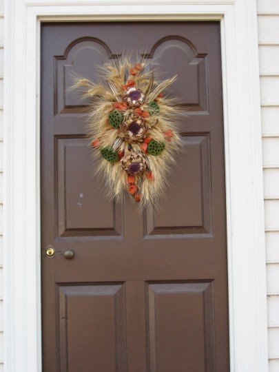 Each Christmas season, residents of Colonial Williamsburg compete for prizes, and praise, by creating remarkable decorations for their doors and windows using only materials that would have been available in the 1700s. (Susan Reimer/Baltimore Sun)