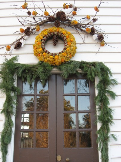 "Wreath designers, both amateur and professional, are ""branching out,"" as seen in this display. (Susan Reimer/Baltimore Sun)"