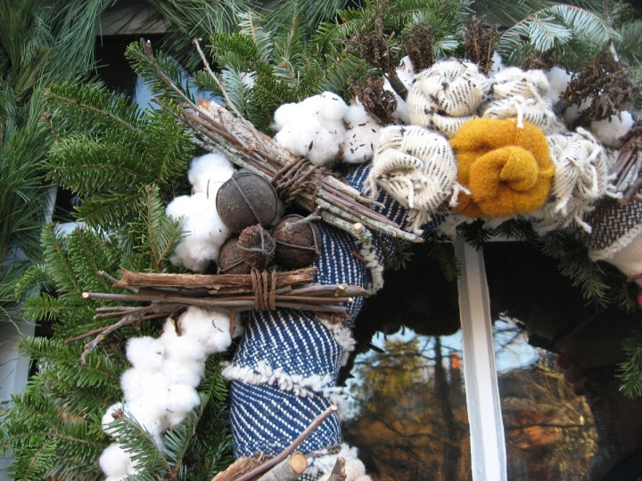 A detail from the weaver's shop in Colonial Williamsburg shows cotton and fabric in the wreath. (Susan Reimer/Baltimore Sun)