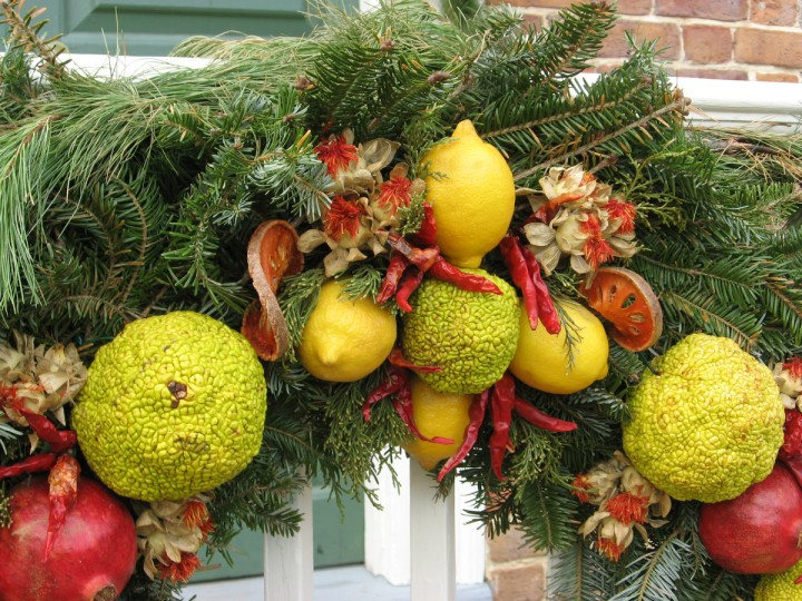 Each Christmas season, residents of Colonial Williamsburg compete for prizes, and praise, by creating remarkable decorations for their doors and windows using only materials that would have been available in the 1700s. Notice the hot peppers. (Susan Reimer/Baltimore Sun)