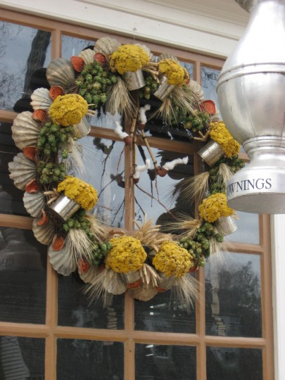 Small tankards and pipes, with raw cotton for smoke, adorn the wreath outside this pub. (Susan Reimer/Baltimore Sun)