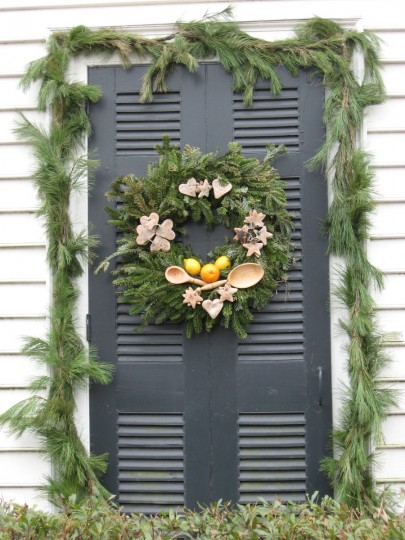 Wooden spoons, cookie cutters and sugar cookies are used to adorn this wreath in Colonial Williamsburg. (Susan Reimer/Baltimore Sun)
