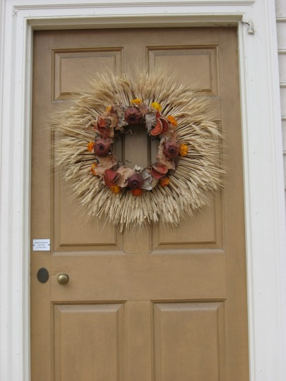 Wheat is used to create an unusual wreath on this door in Colonial Williamsburg. Susan Reimer/Baltimore Sun
