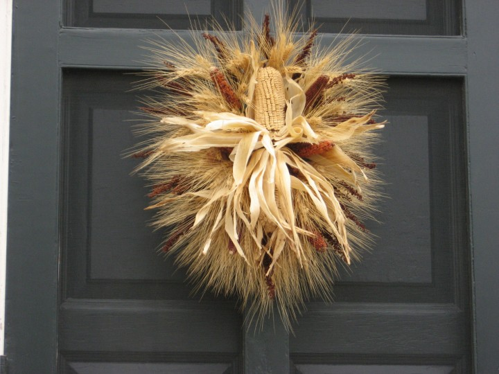 Dried corn creates a candle-like effect in this wreath. (Susan Reimer/Baltimore Sun)