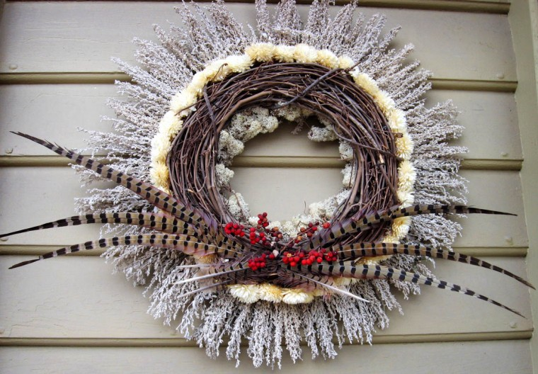 Feathers have become a popular element in wreaths. (Susan Reimer/Baltimore Sun)