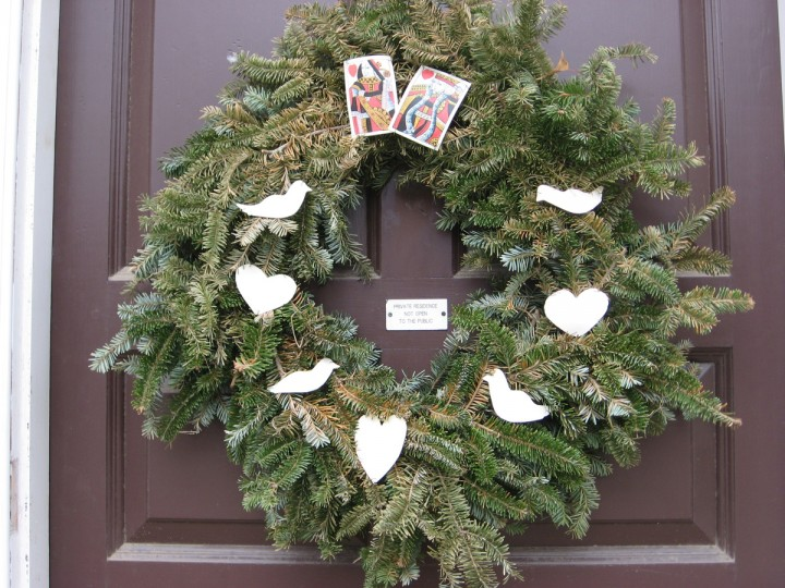 Each Christmas season, residents of Colonial Williamsburg compete for prizes, and praise, by creating remarkable decorations for their doors and windows using only materials that would have been available in the 1700s. A game of cards, anyone? (Susan Reimer/Baltimore Sun)